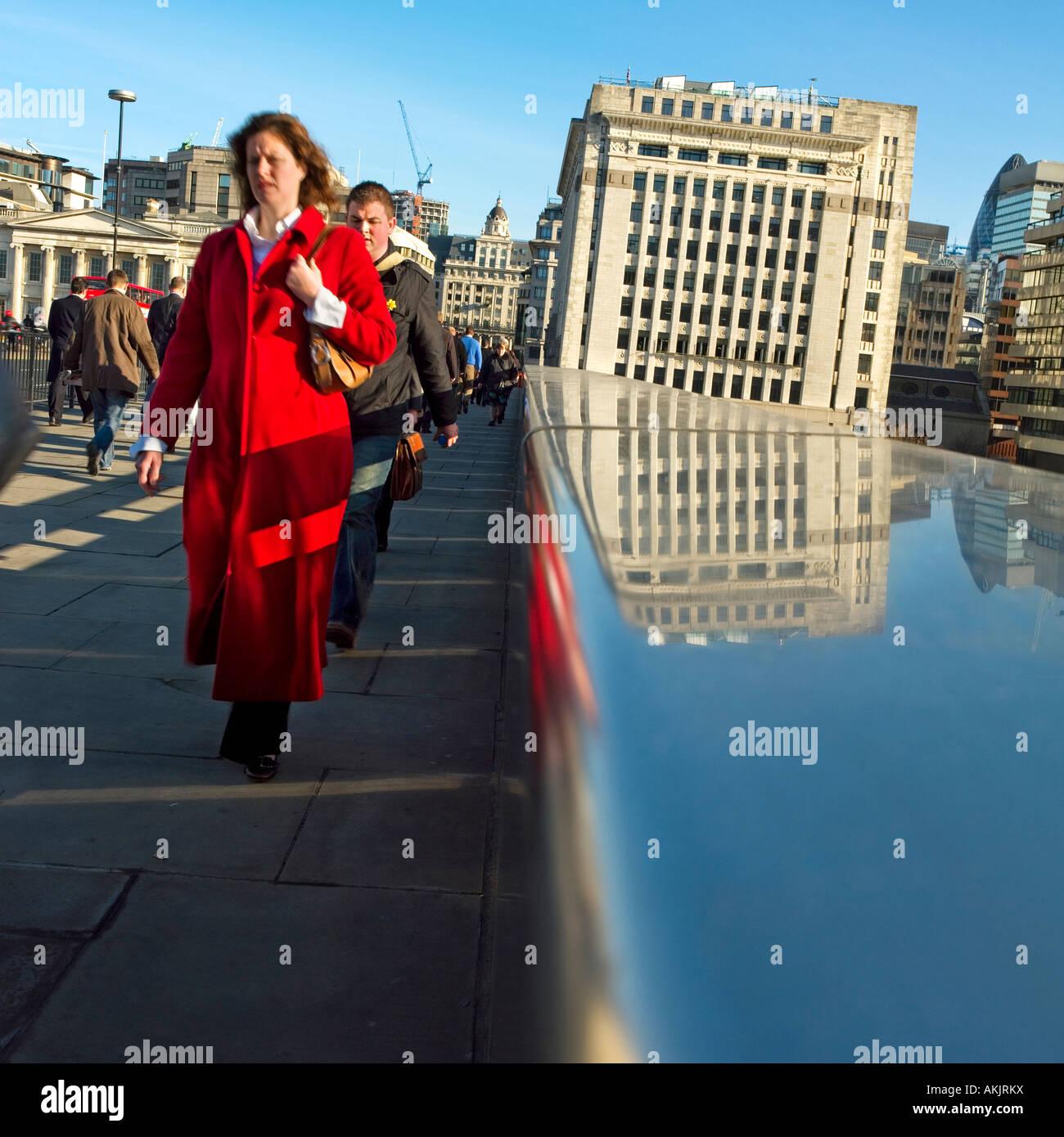 Early Morning London Commuters Crossing Bridge Woman In Red Coat