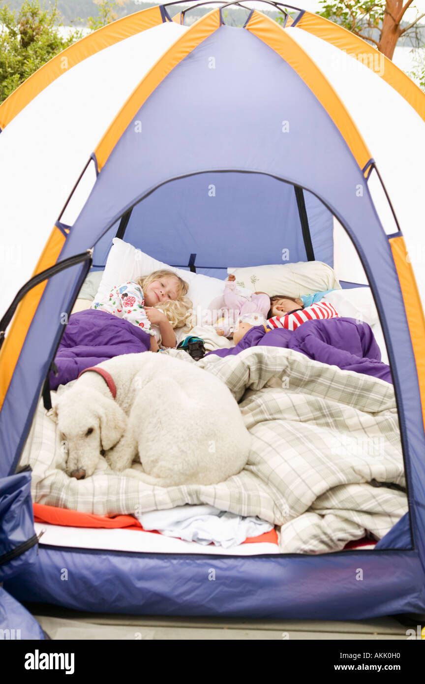 Young girls sleeping in tent with dog & Young girls sleeping in tent with dog Stock Photo Royalty Free ...