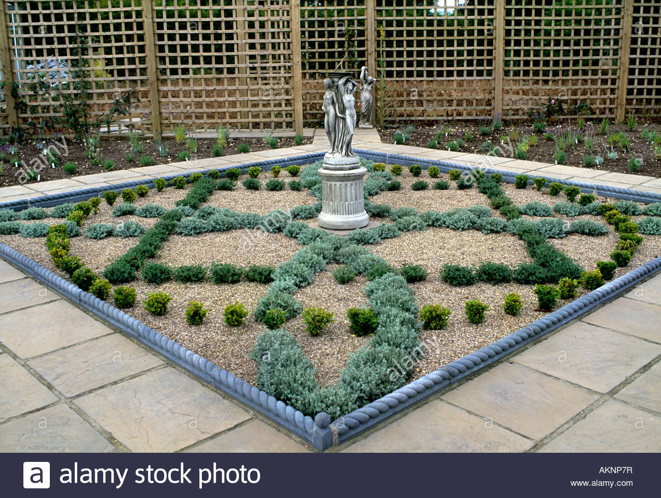 Newly built planted small herb garden with knot design of for Knot garden designs herbs