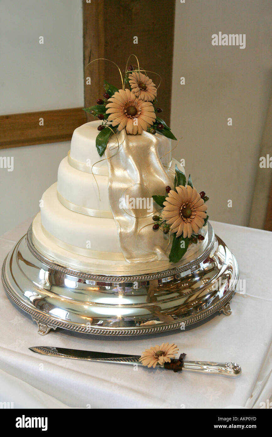 Closeup Of A Spring Themed Wedding Cake On A Silver Cake Stand With Ornate  Silver Knife UK