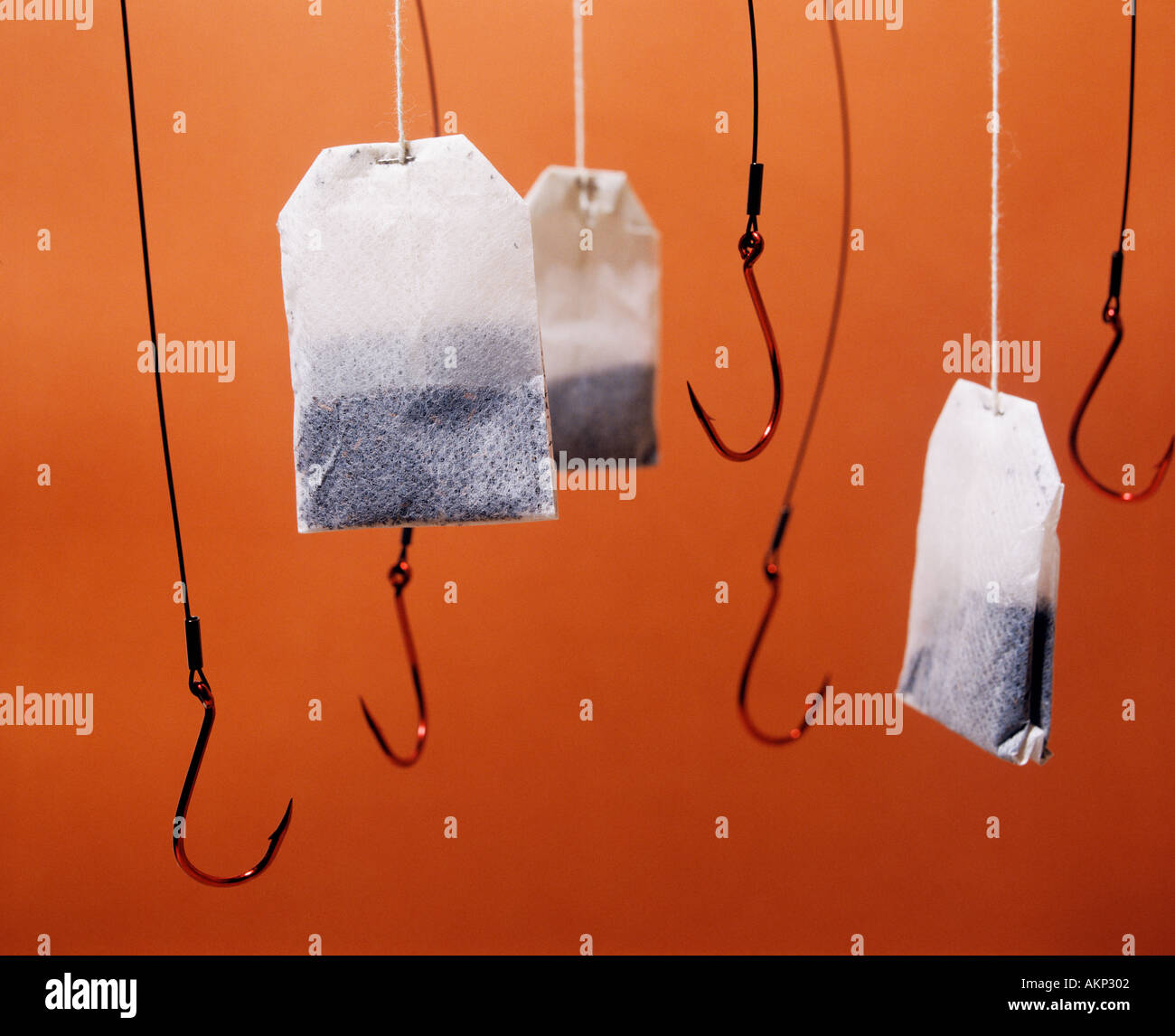 Hanging tea bags with large red fish hooks Stock Photo ...