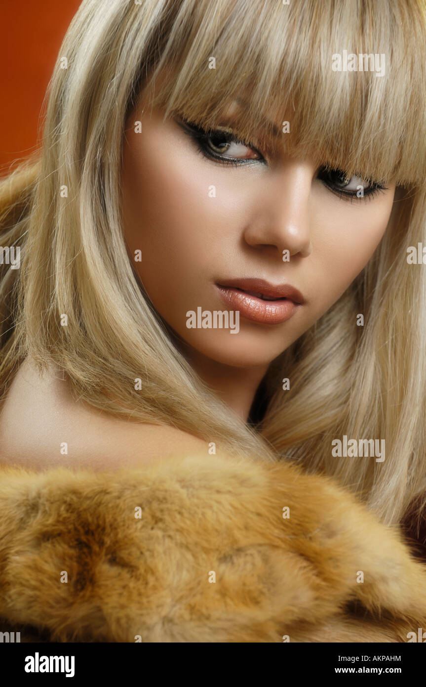 Beautiful blond foxy woman with shiny golden hair wearing ...