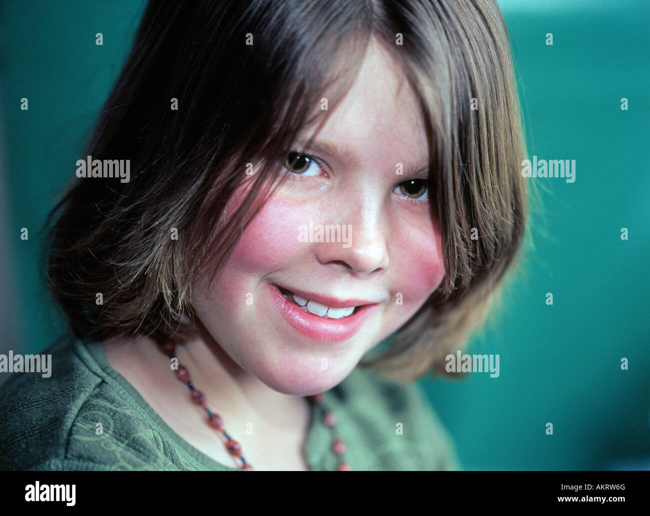 A young middle school girl with blushing cheeks Stock Photo ...