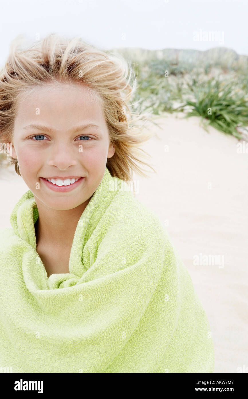 teenboy Pre-teen Boy Wrapped in a Towel, standing on beach