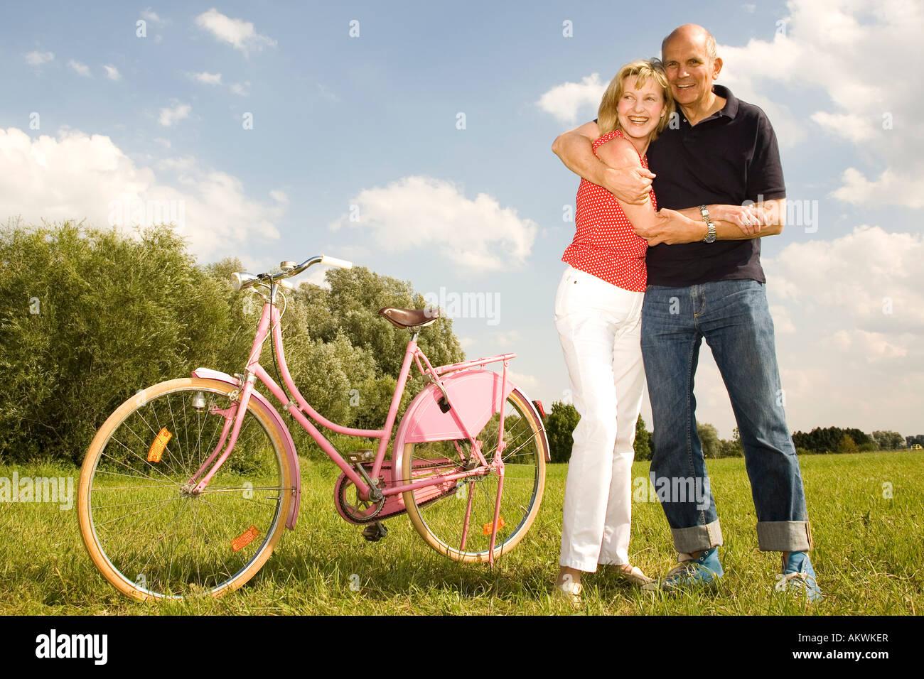 mature couple riding bike stock photo: 15081310 - alamy
