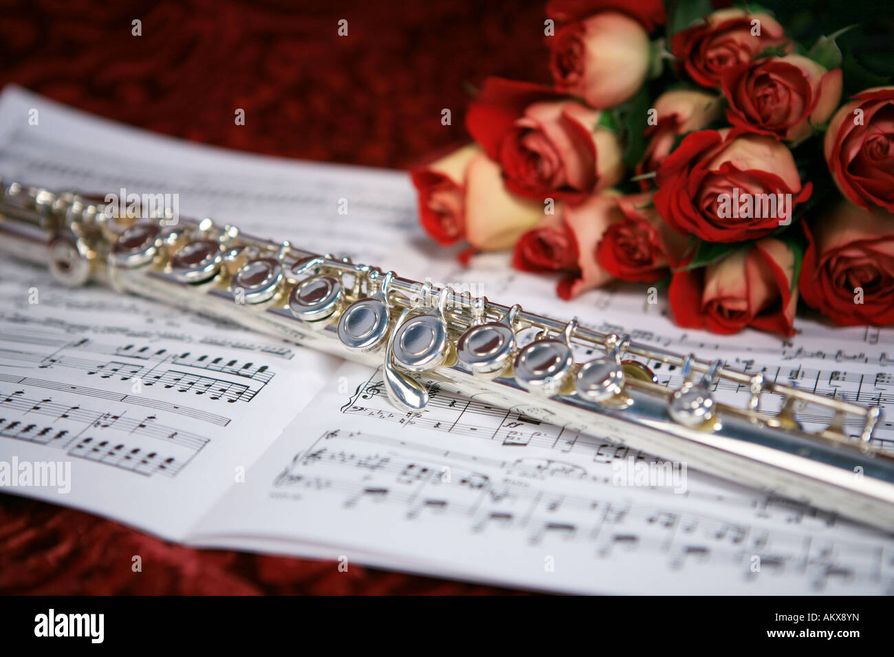 Simple Wallpaper Music Rose - silver-flute-on-sheet-music-with-bouquet-of-roses-on-red-velvet-background-AKX8YN  Image_61905.jpg