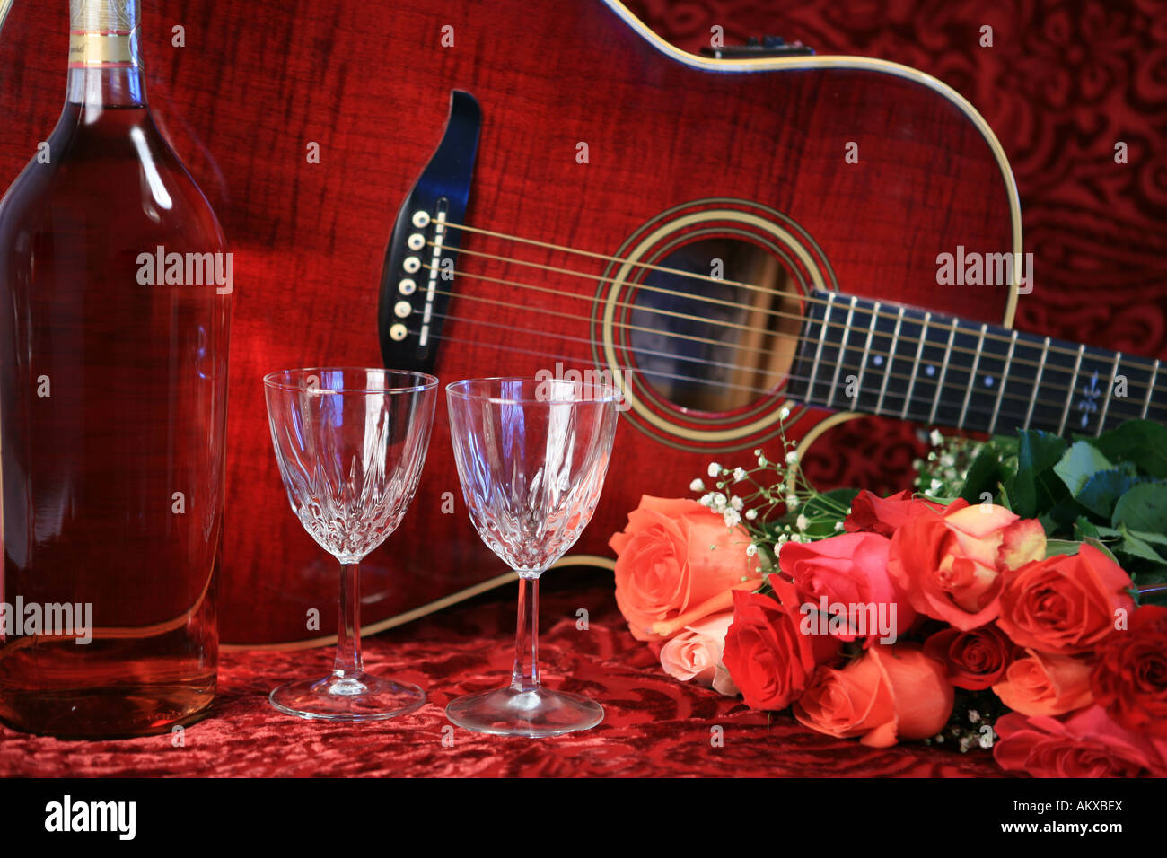 Red Acoustic Guitar With Wine And Roses