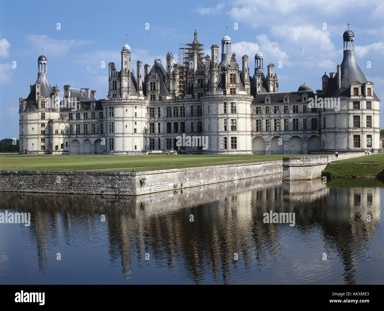 The 16th Century French Renaissance Chateau De Chambord Reflecting On Water In Foreground France
