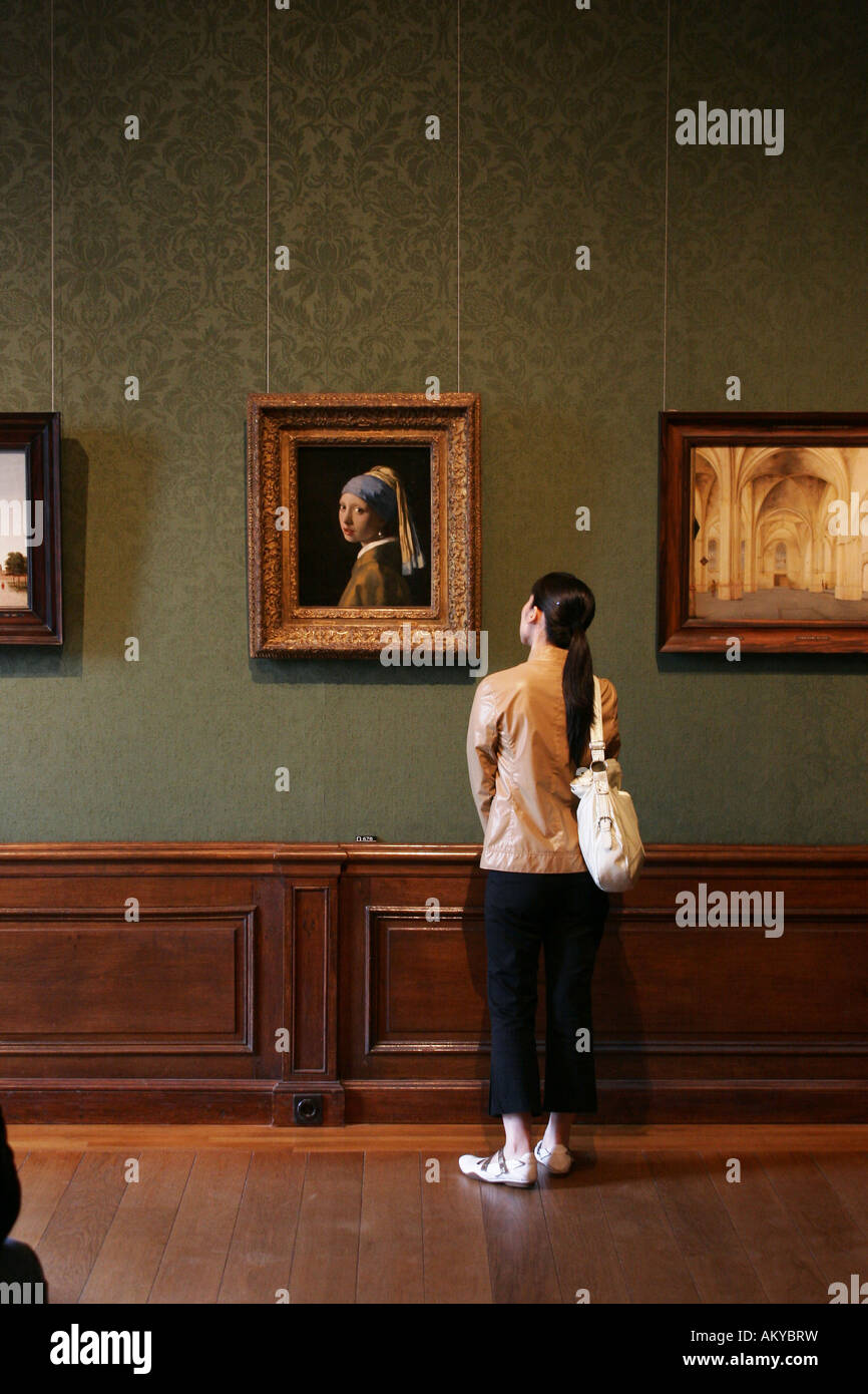 Girl Watching The Famous Painting 'girl With A Pearl Earring ' By Dutch  Painter Johannes