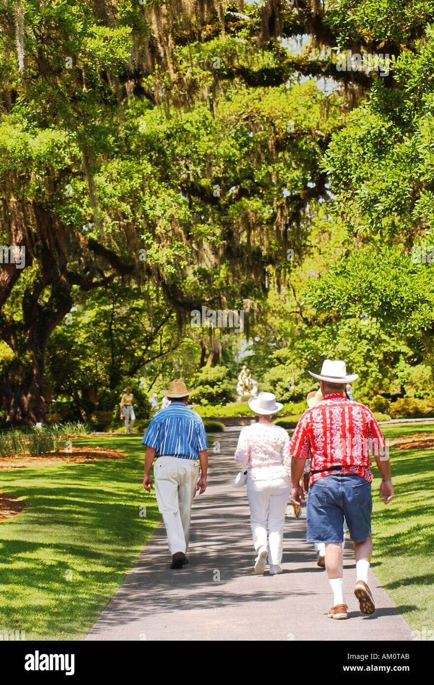 Tourists stroll down path at Brookgreen Gardens in Myrtle Beach ...