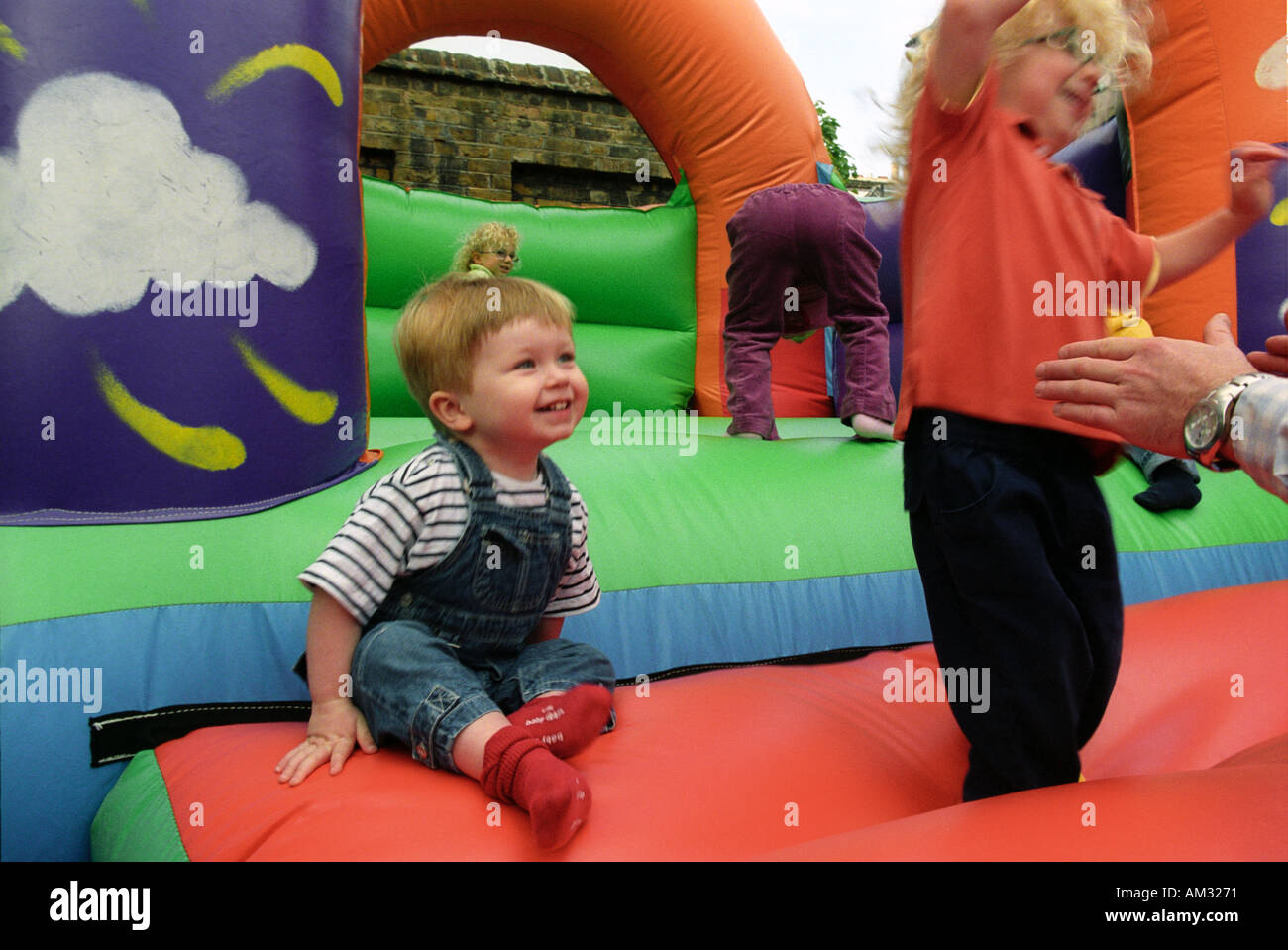Young Children And Toddlers Playing On Soft Play Area Stock Photo