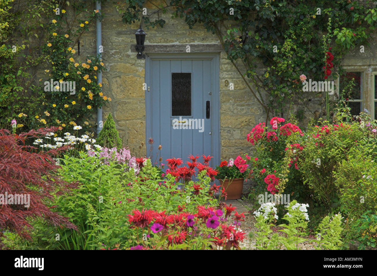 Front door of an old english cottage - Front Door Of Quaint Old Cotswold Cottage Bibury England Uk Gb Eu Europe