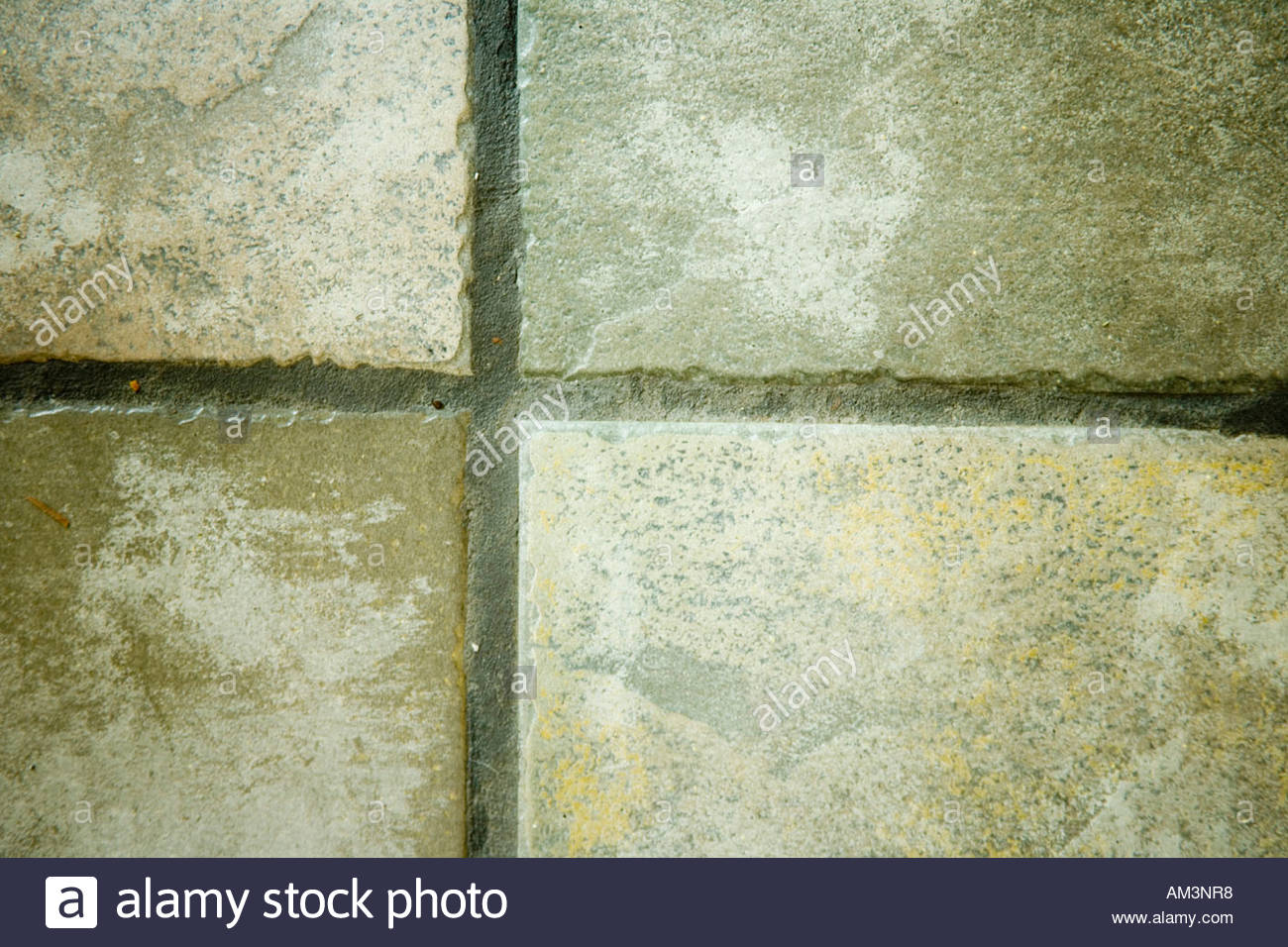 Intersection of rustic ceramic floor tiles with dark grey grout intersection of rustic ceramic floor tiles with dark grey grout dailygadgetfo Choice Image