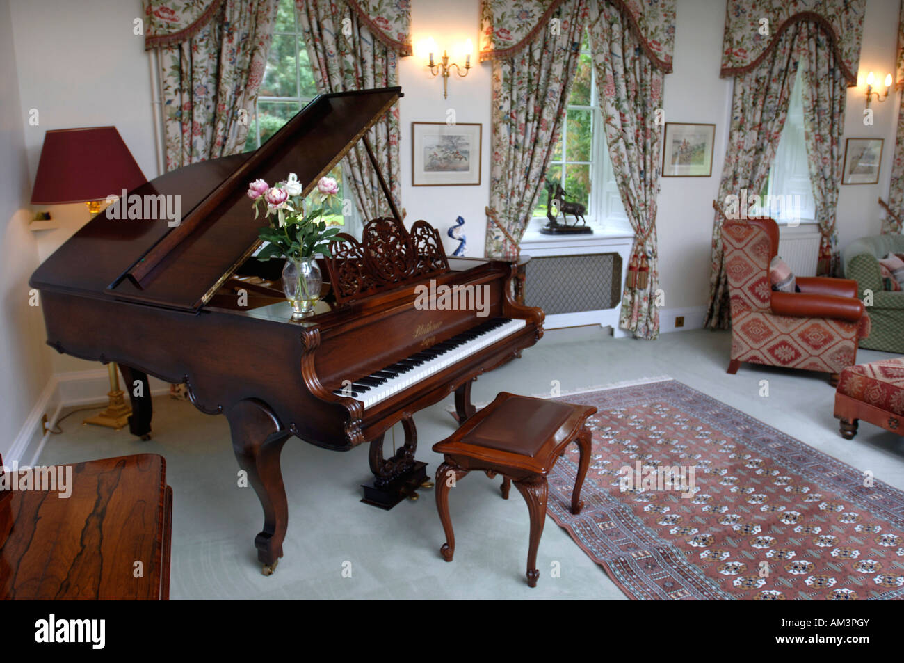 An Antique Bluthner Grand Piano In A Living Room Uk Stock