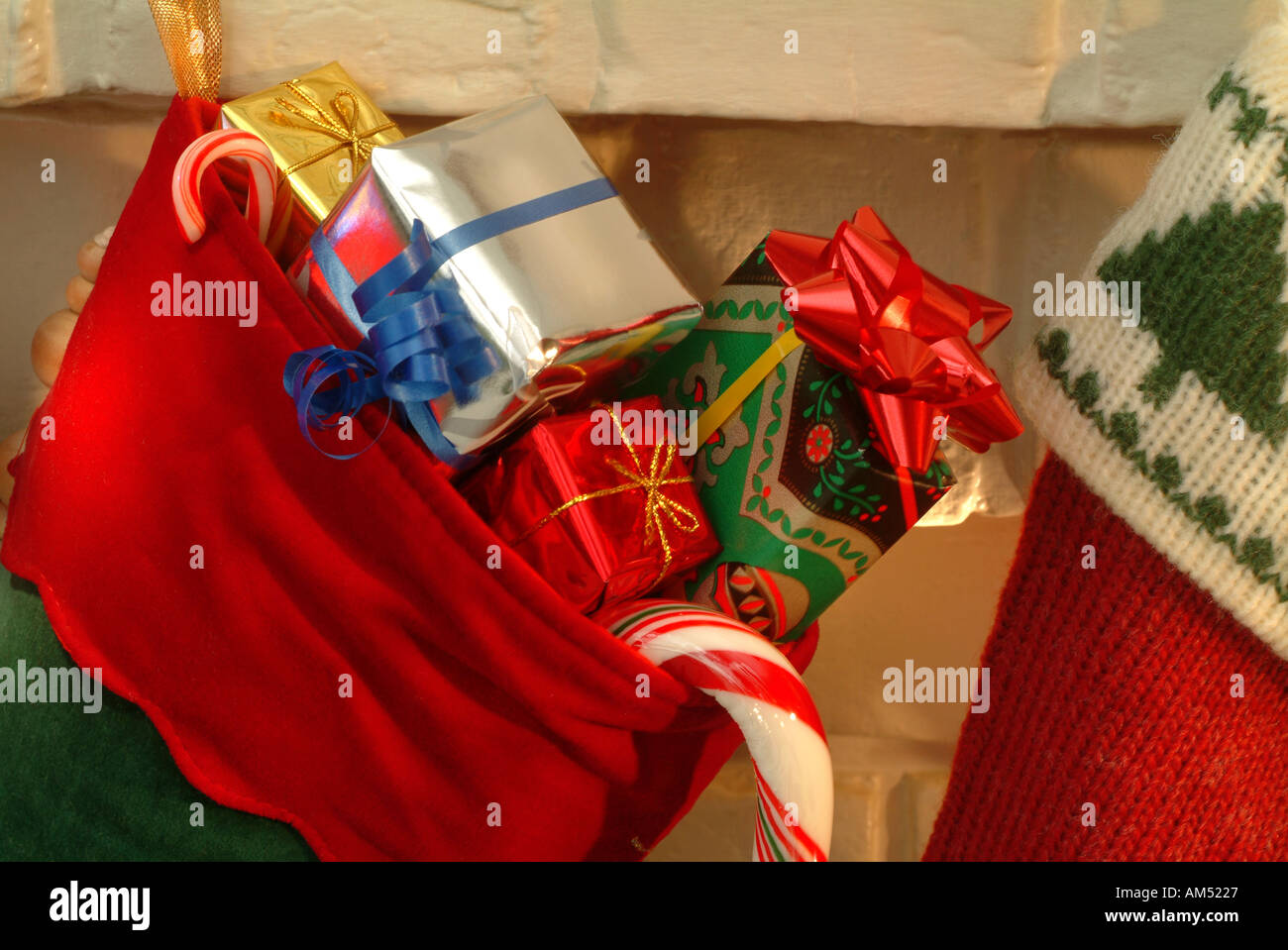 christmas stockings full of gifts pinned to a fireplace mantle at