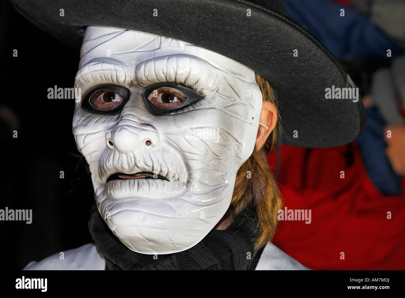 Young woman wearing mask of a ancient man, Halloween event for ...