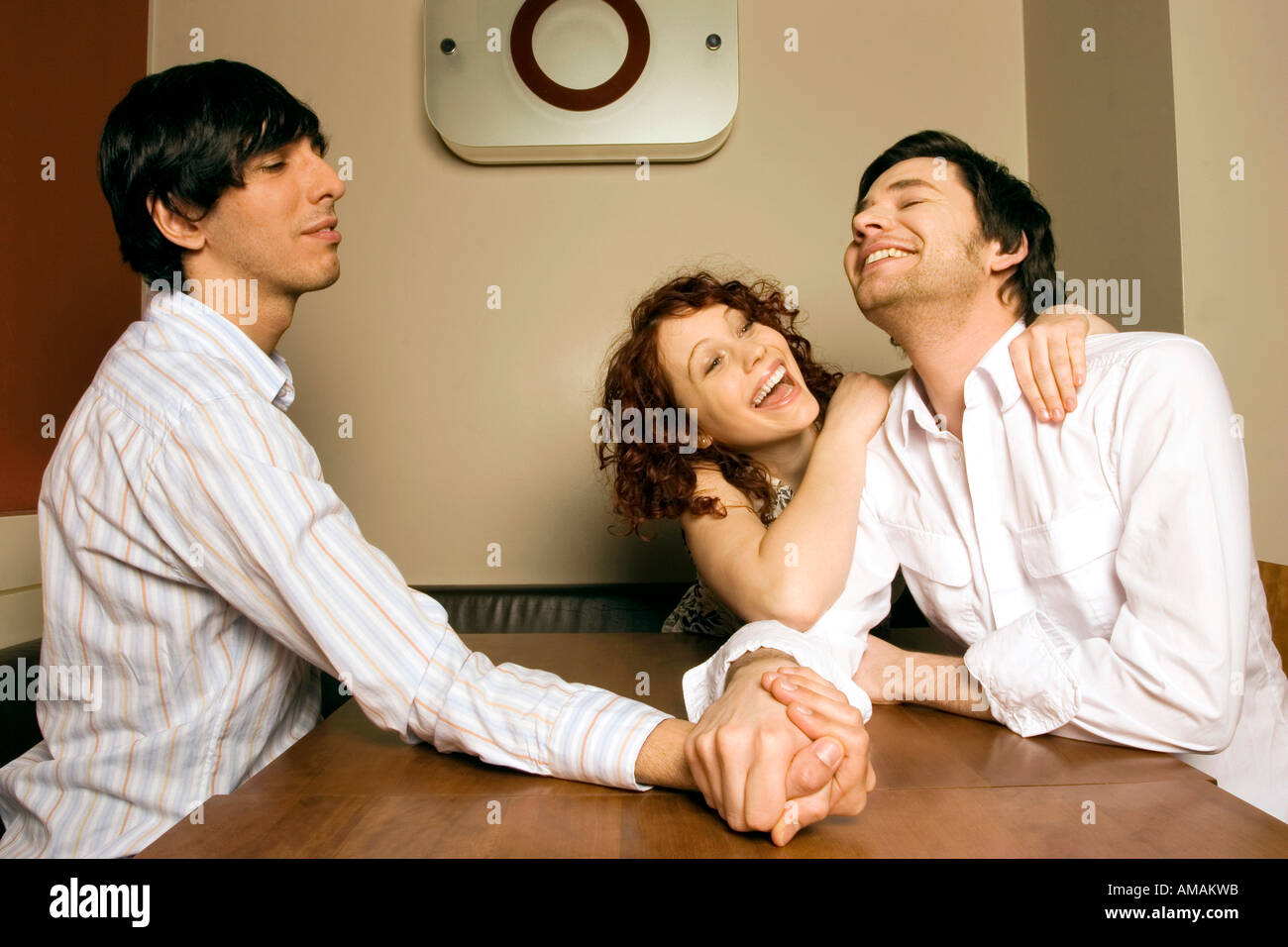 women watching men arm wrestling smiling stock photo royalty stock photo women watching men arm wrestling smiling