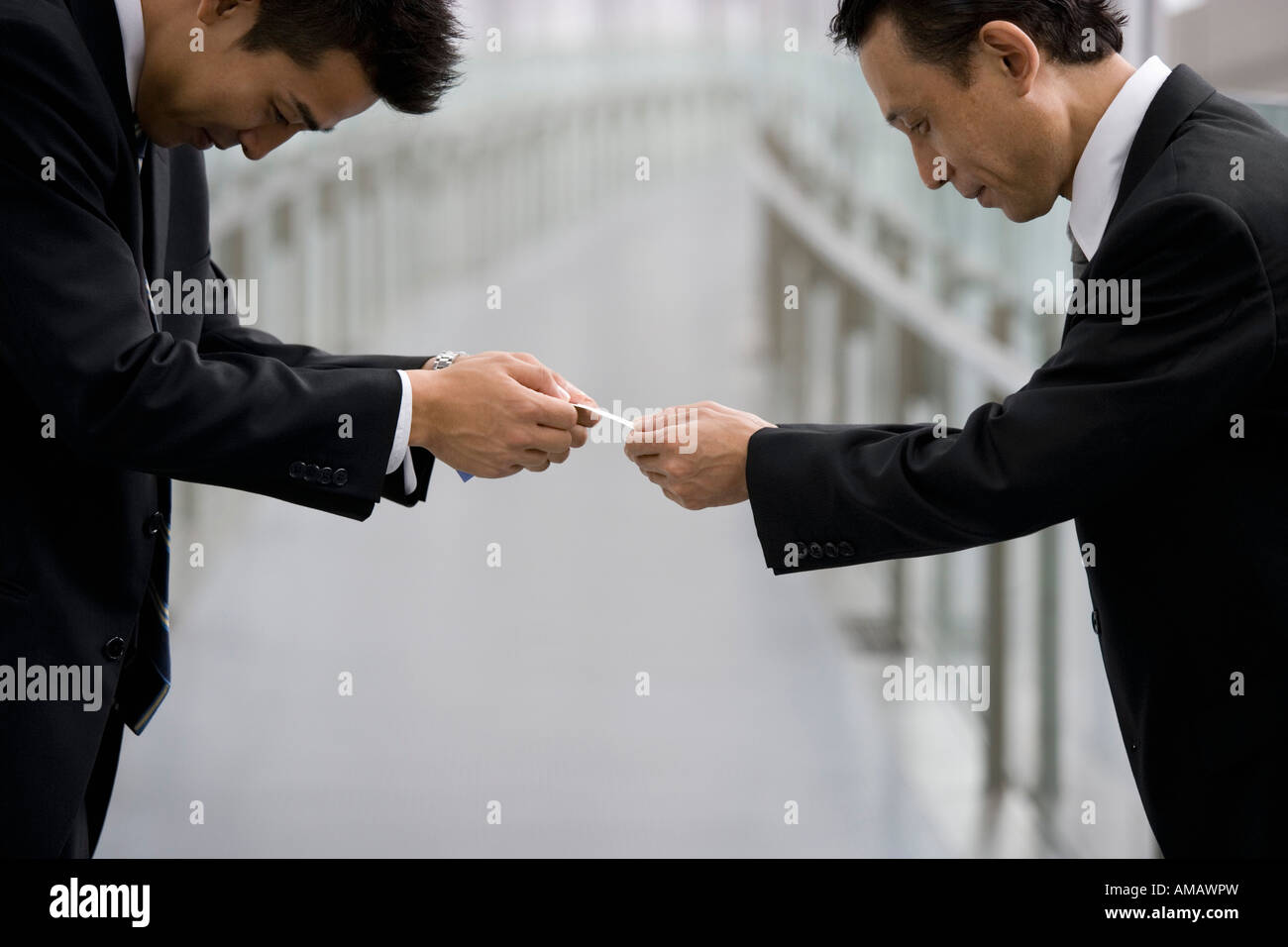 Japanese businessmen exchanging business cards Stock Photo ...