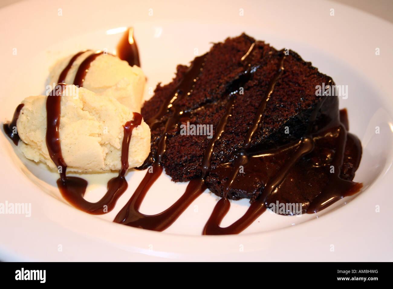Chocolate Fudge cake and vanilla ice cream Stock Photo ...