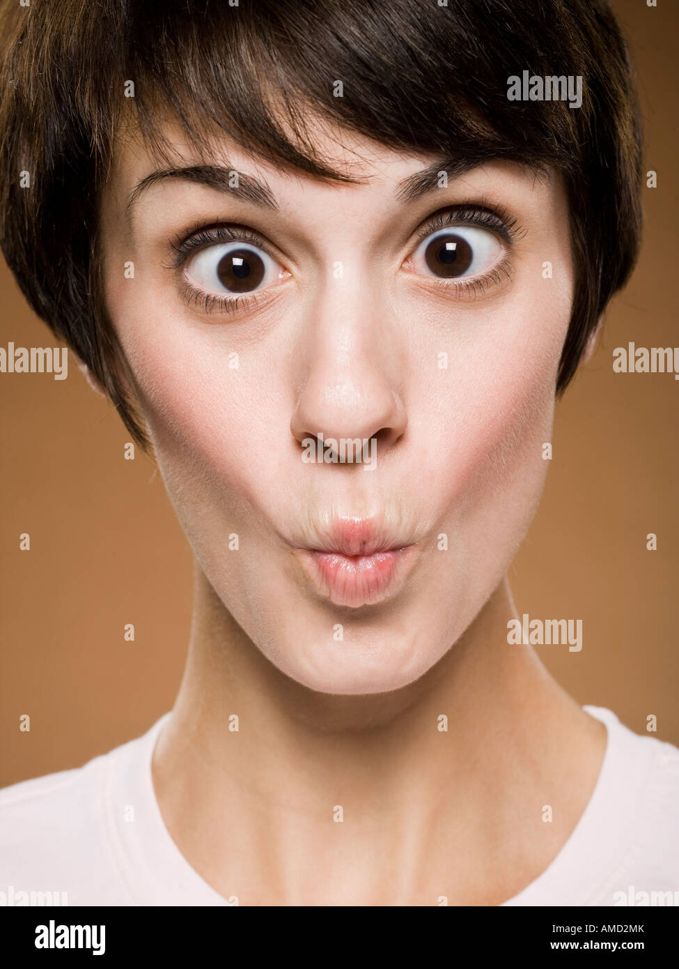 Grimace face clip art stock photo woman pulls a face in upset - Woman Making Funny Face With Eyes Crossed And Puckered Lips Stock Image