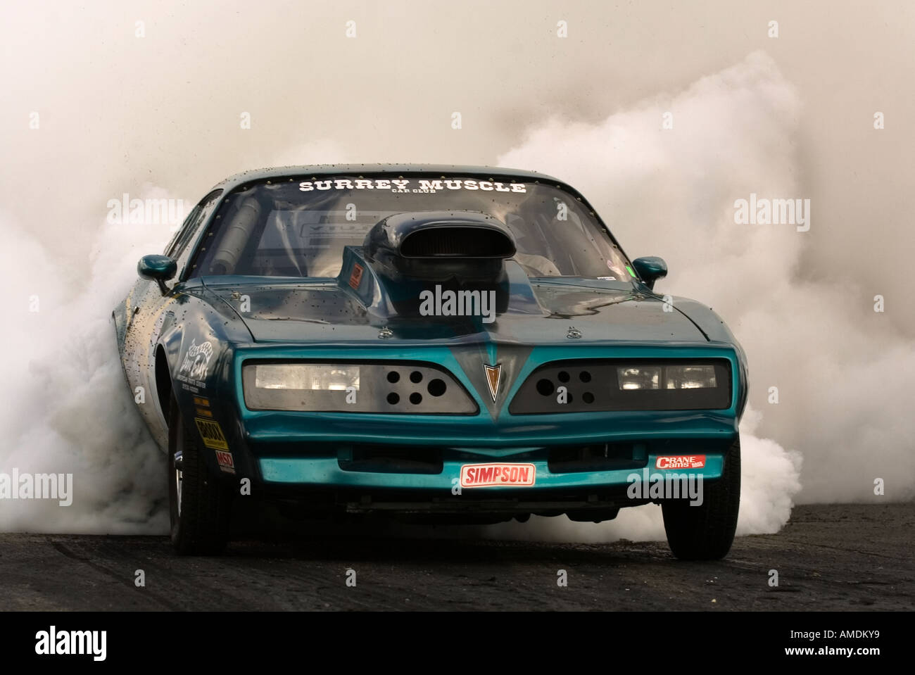 A Suped Up Muscle Car Warms Its Tyres Before Competing In The - Suped up