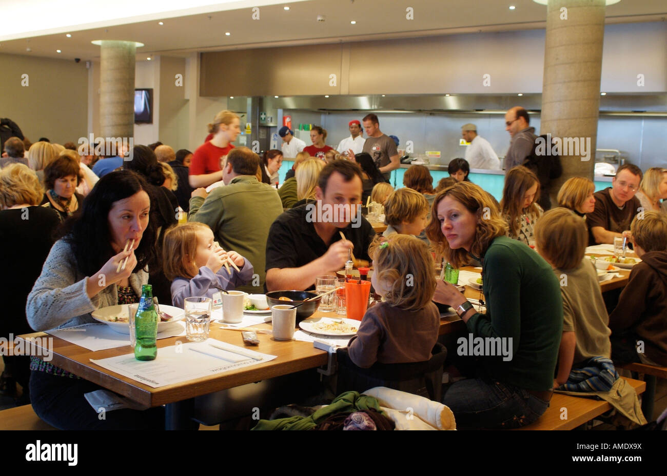 Crowded restaurant table - Crowded Restaurant With Customers Eating At A Wagamama Noodle Bar Establishment Stock Image