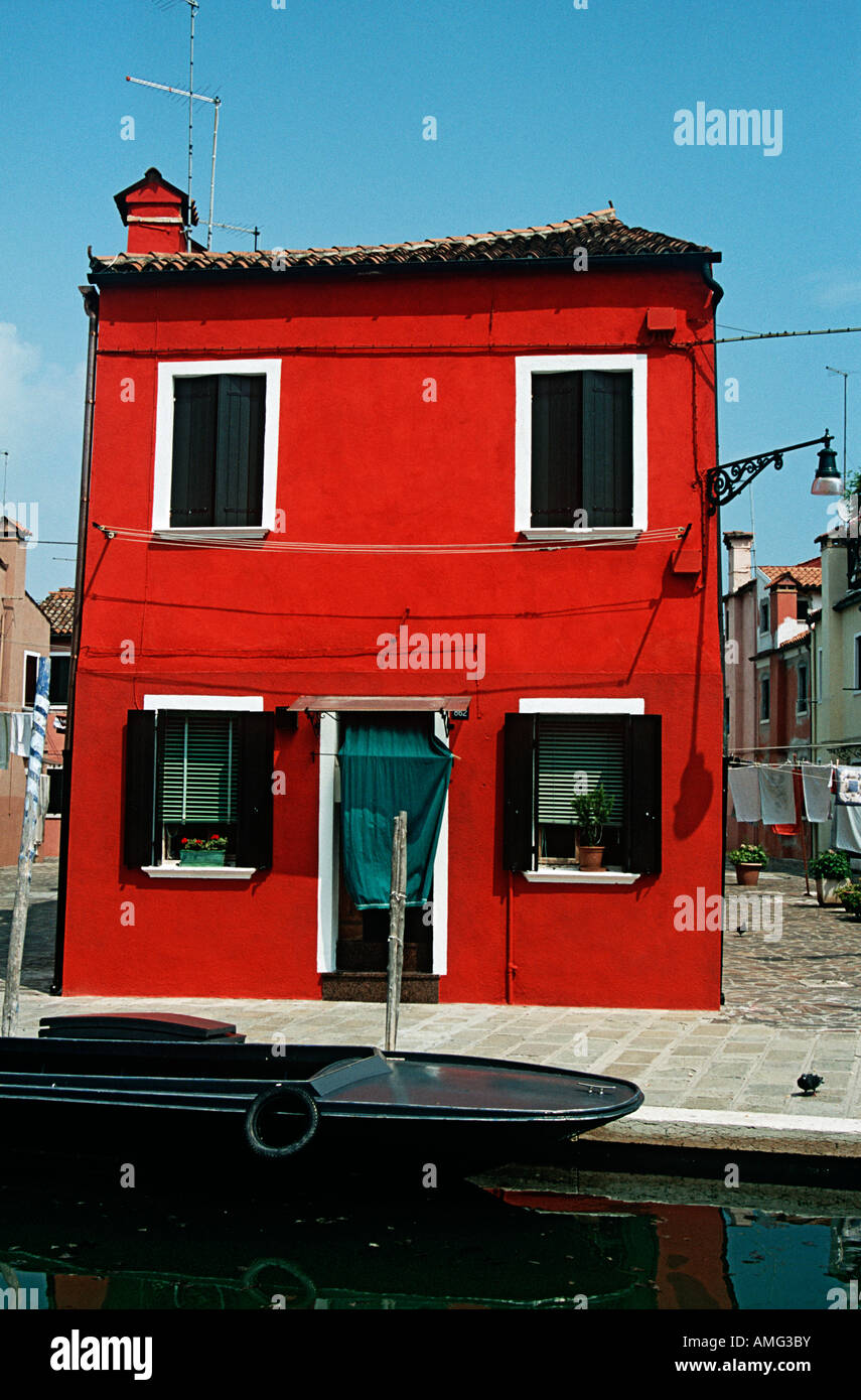 Elegant Red Painted House, Typical Of Island Of Burano, Beside A Canal, Burano,  Venice, Italy