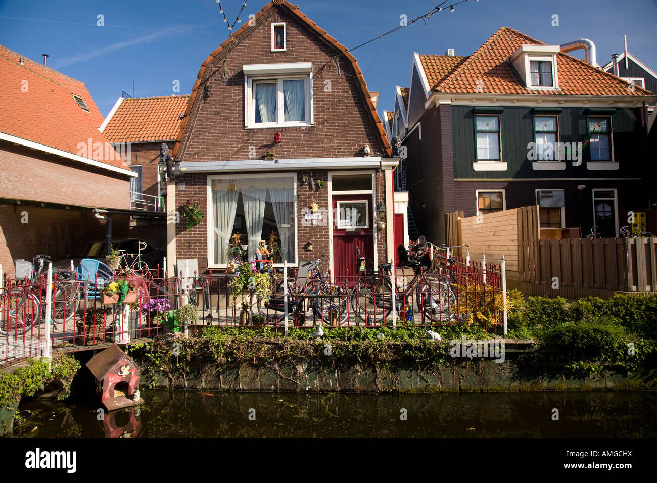 Front yard of a dutch house near the town of vollendam in for Dutch house