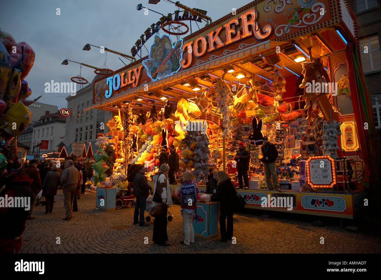 tourists walk past funfair chance game spandau christmas market stock photo royalty free image. Black Bedroom Furniture Sets. Home Design Ideas