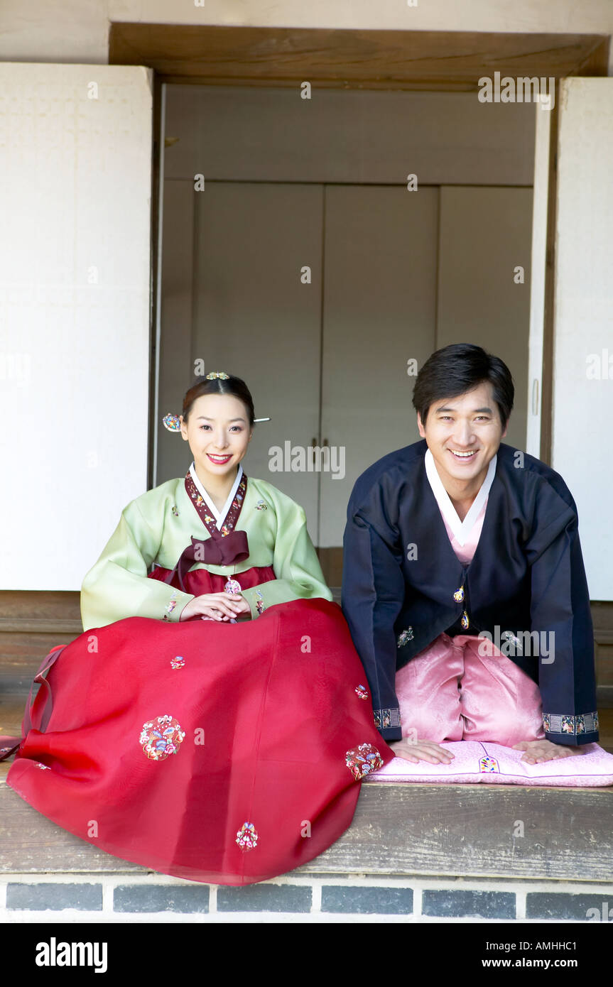 A couple in hanbok greet in korean way stock photo royalty free a couple in hanbok greet in korean way kristyandbryce Choice Image