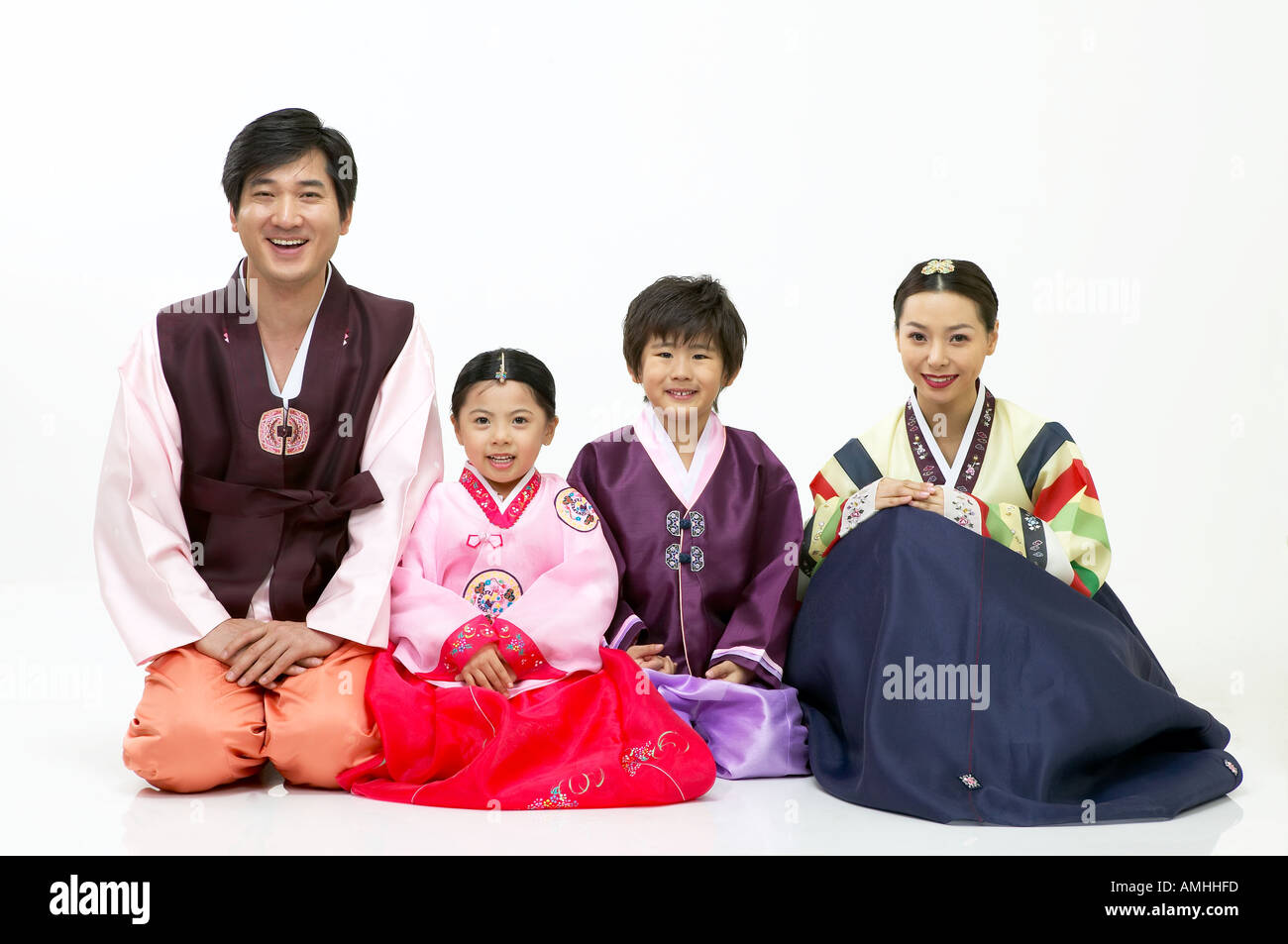 A family in hanbok greet in korean way stock photo royalty free a family in hanbok greet in korean way kristyandbryce Choice Image
