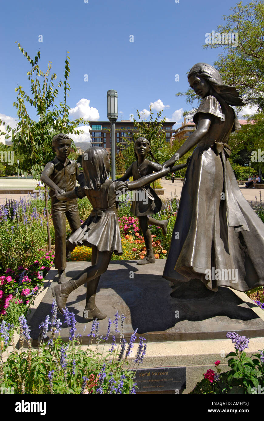 statue of mormon woman with children at the church of jesus christ