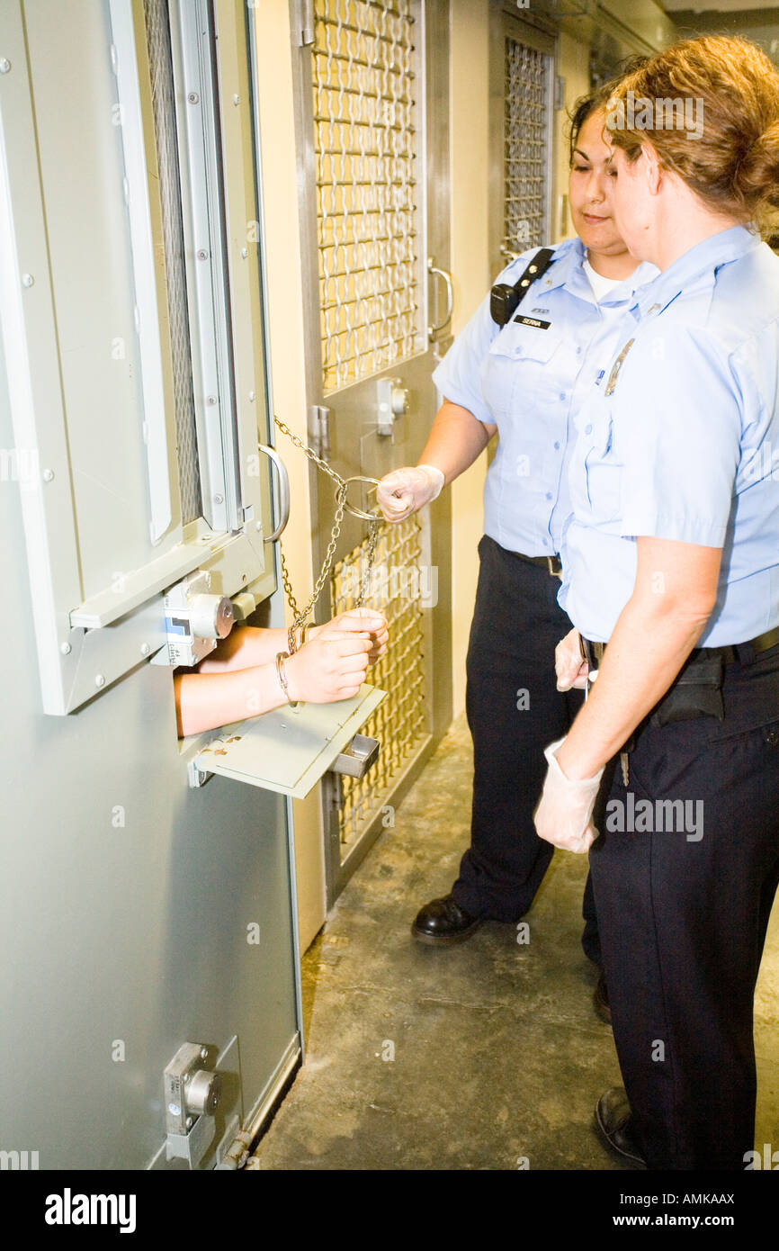 Female Correctional Officers Handcuffing Inmate In
