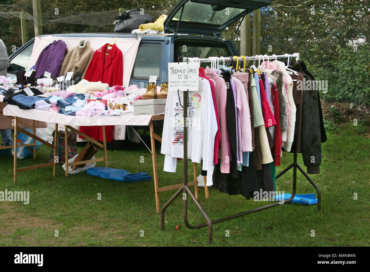 Stall at a car boot sale with general items and clothes