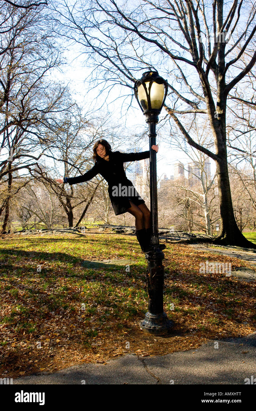 young girl celebrating central park by climbing lamp post Stock ...