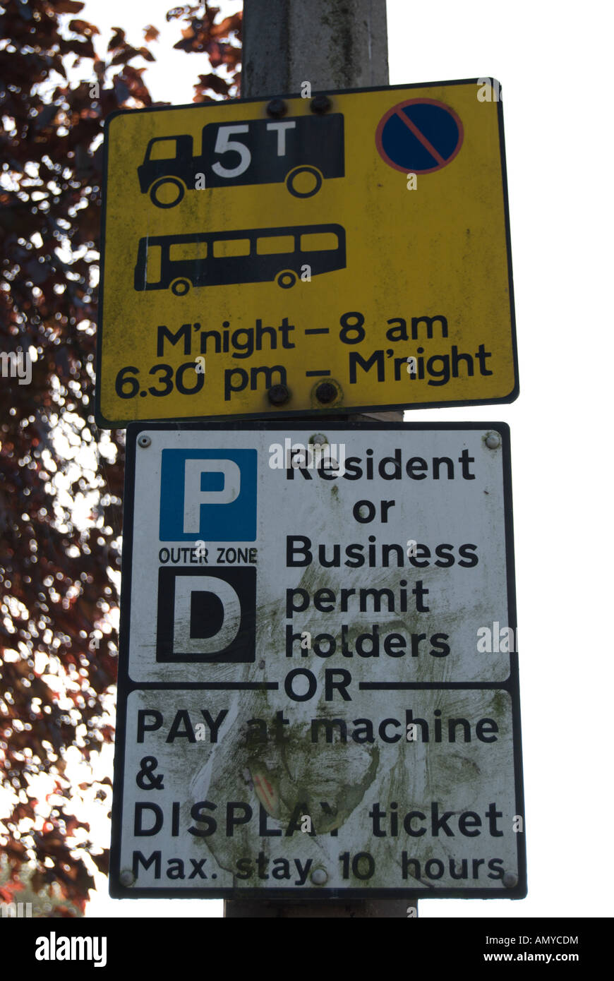two dirty road signs fixed to a lamppost in twickenham