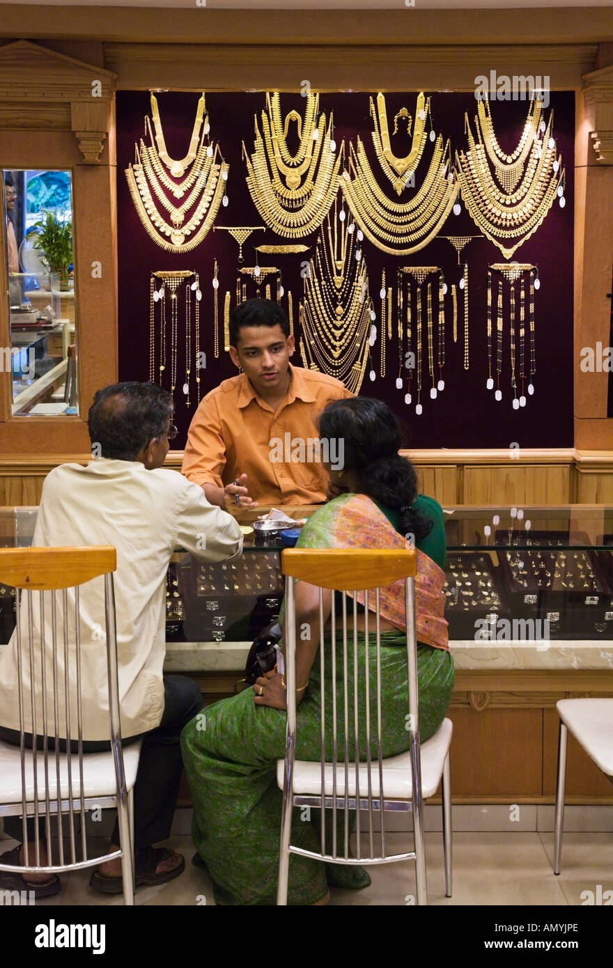 India Kerala Trivandrum Gold shop interior with couple buying gold ...