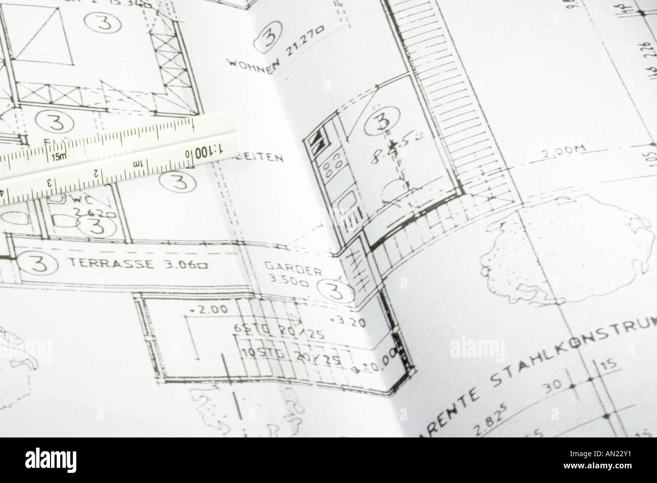 cad blueprint of a house ruler lying on the plan stock photo