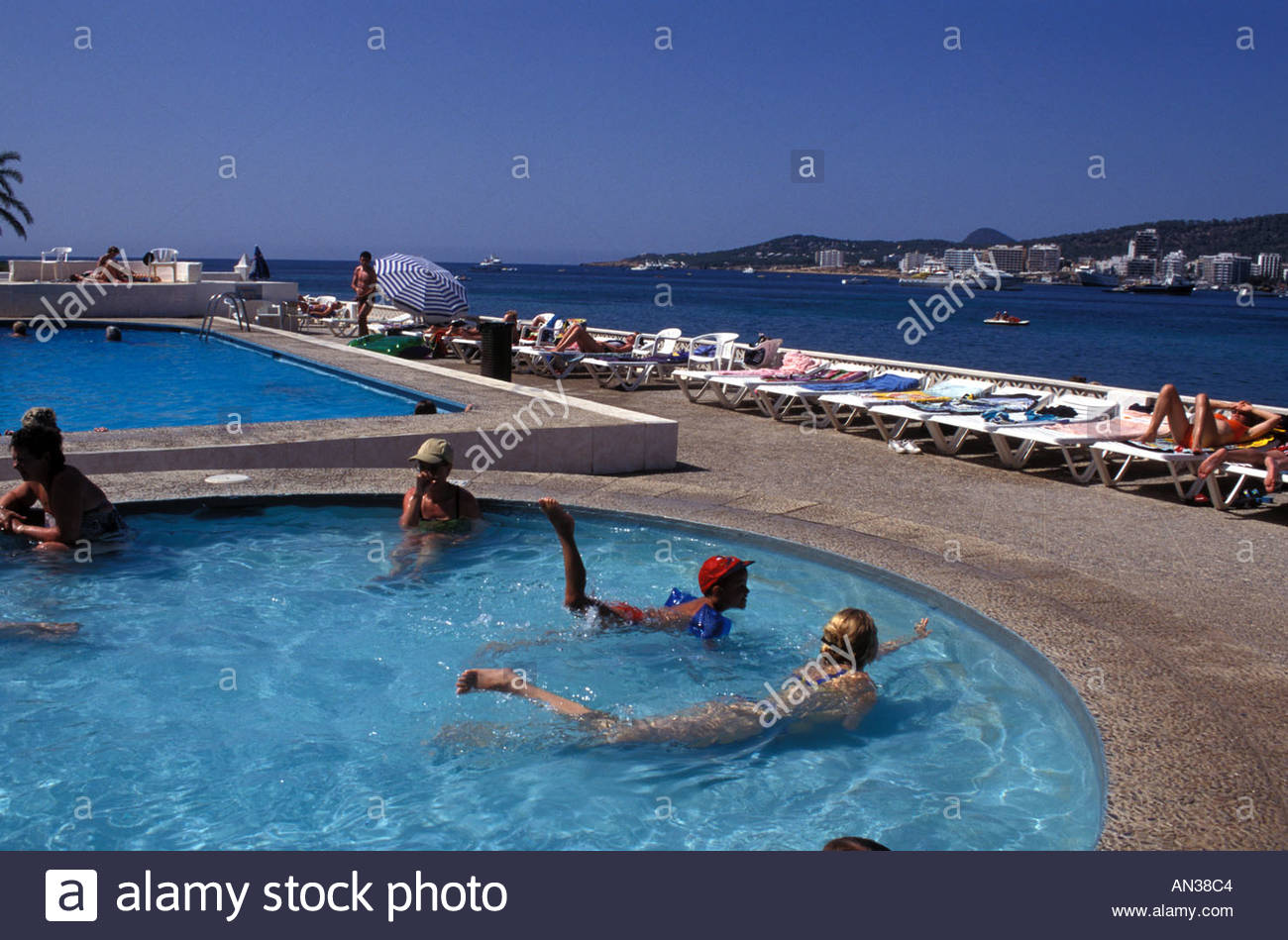 Hotel pool with people  People swimming in the hotel pool San Antonio Ibiza Spain Stock ...