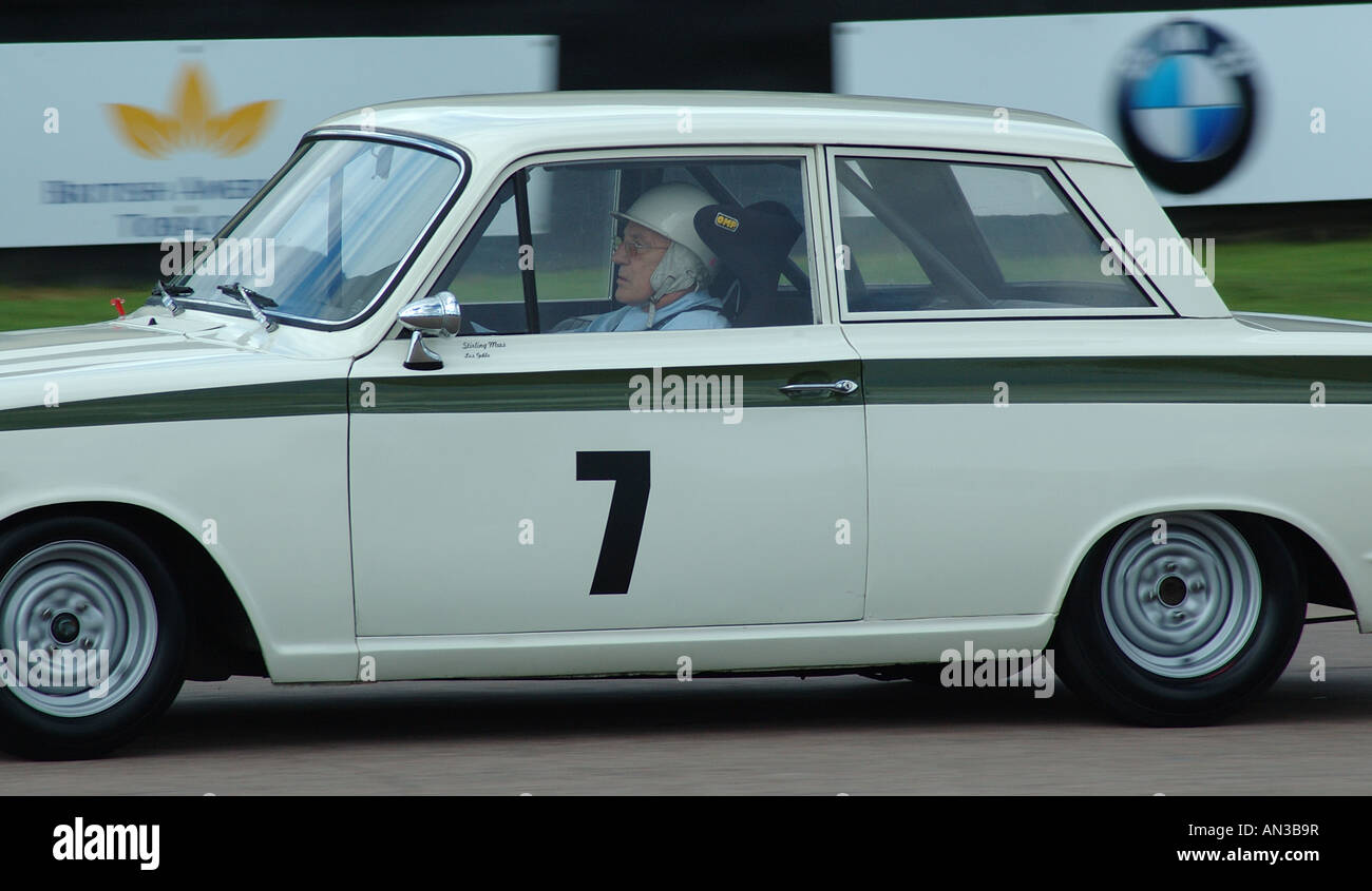 sir stirling moss racing a lotus cortina mk1 at goodwood revival sussex england uk stock