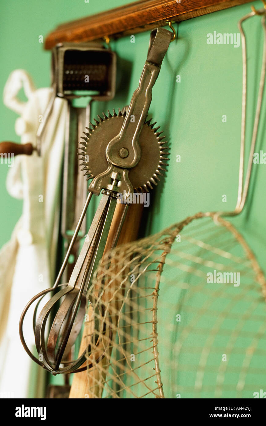 Vintage kitchen gadgets - Stock Photo Vintage Kitchen Gadgets Hanging On A Wall