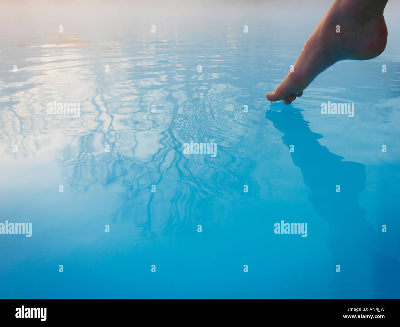 Toe Feeling Water Temperature In Outdoor Swimming Pool Stock Photo Royalty Free Image 15410304