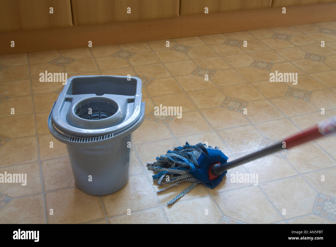 Kitchen Floor Mops Studio Close Up Washing A Kitchen Floor Using A Blue Fabric Mop