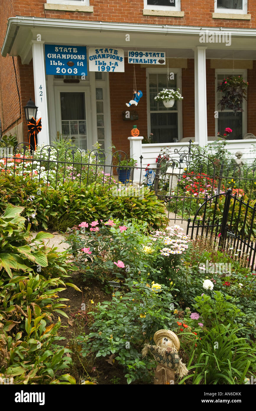 ILLINOIS Galena Front porch with fall decorations flowers in garden ...