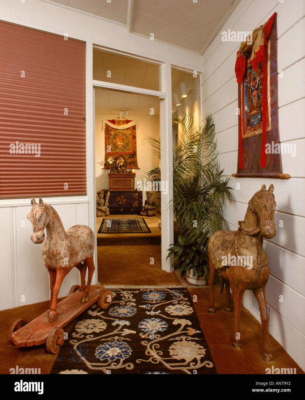 ENTRY HALL and BEDROOM with ASIAN MOTIF Tibetan rugs Buddhist Thankas and  Thai antique wooden horses. Entry Hall And Bedroom With Asian Motif Tibetan Rugs Buddhist
