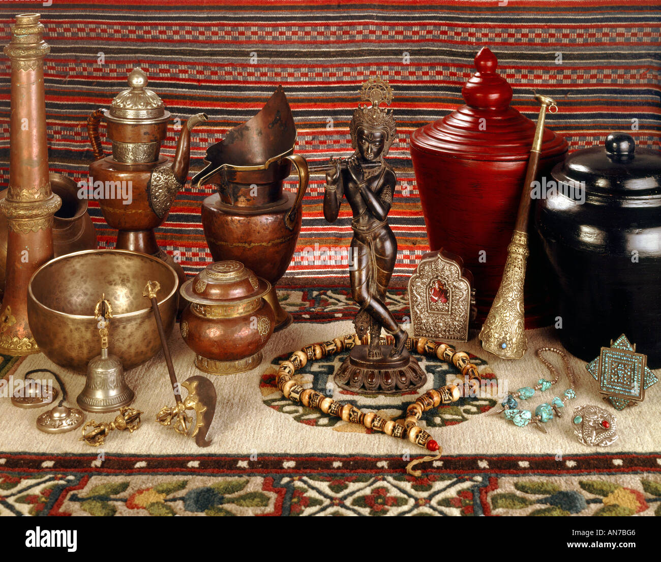 Asian Artifacts asian artifacts ritual objects with krishna statue stock photo