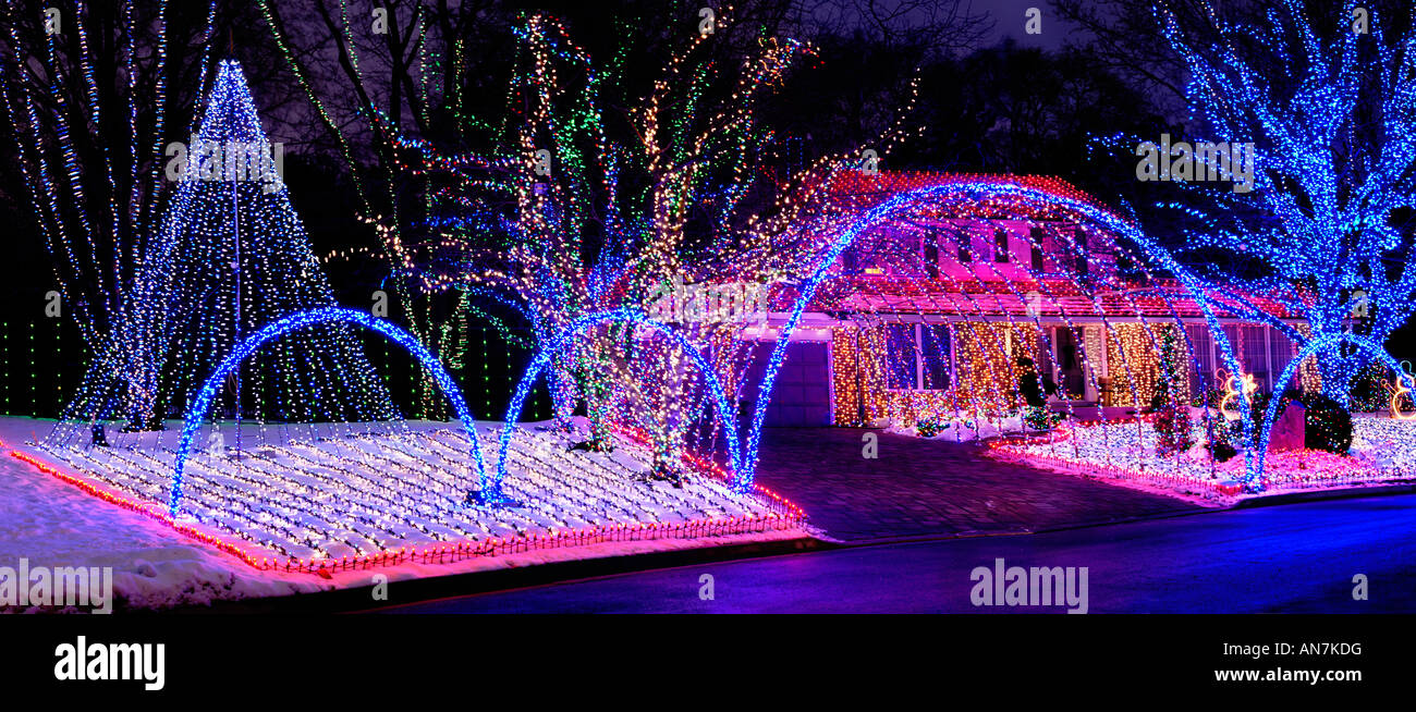 House Decorated With Colorful Christmas Lights Shining At