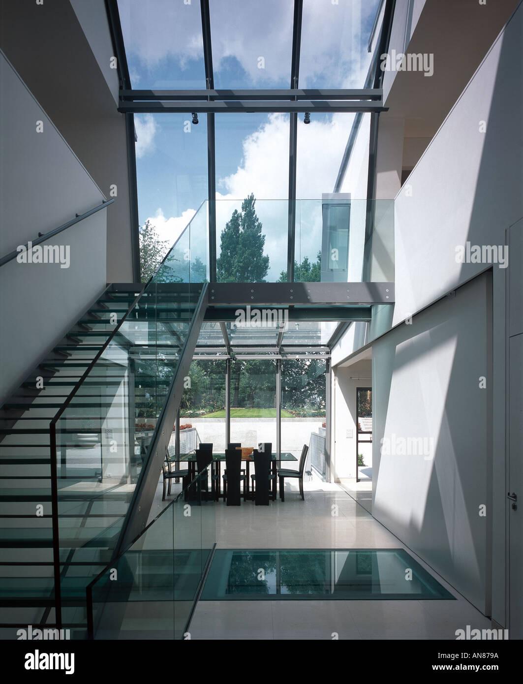 basement pool house. Modern House With Basement Pool, Hampstead - Interior Atrium. Architect: Belsize Architects Pool B