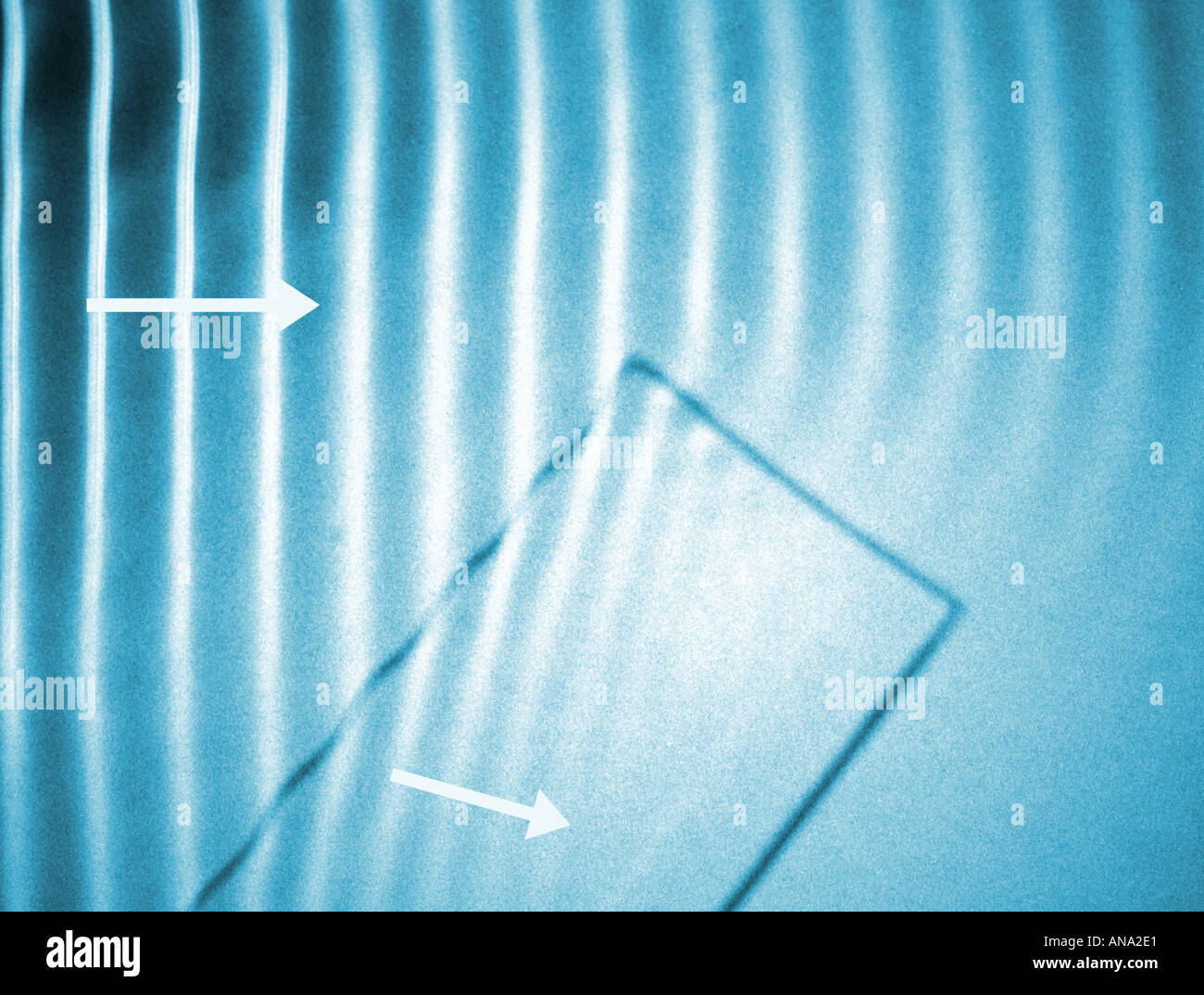 refraction of water waves going from deep to shallow water in a ...