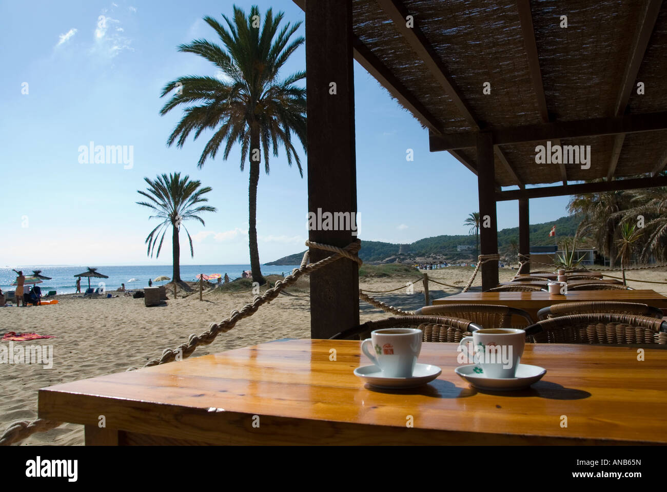 coffee cups on a wooden table in a beach cafe, overlooking the